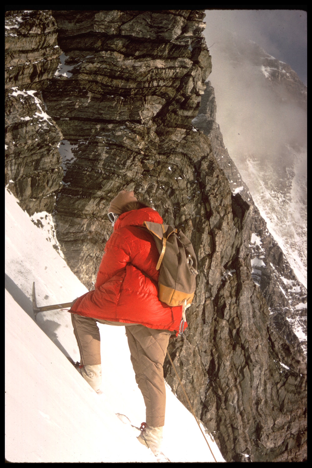 Cutting steps in the snow with an ice axe