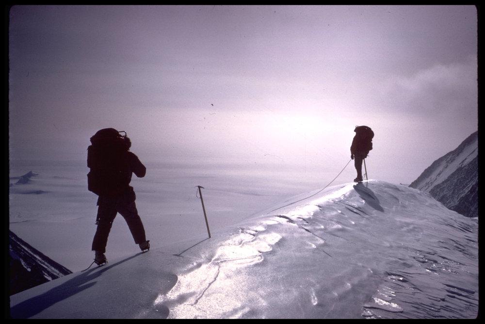 An ice axe on an icy hump