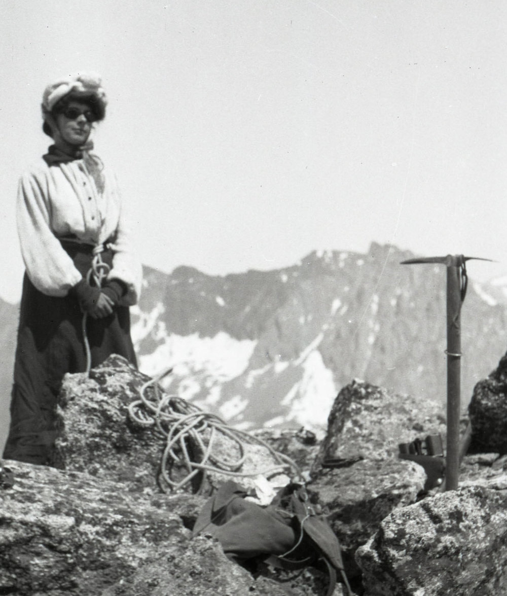 A woman summits in the Alps