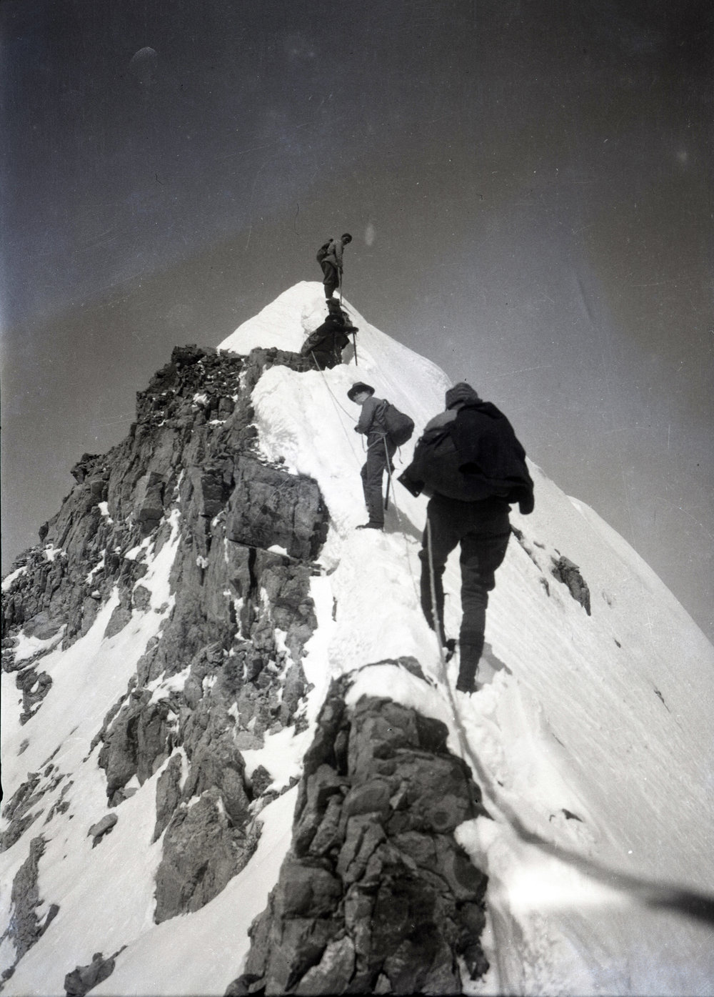 A climbing group summiting Victoria Ridge in Alberta.