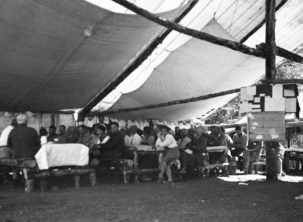 Campers gathering in a mess tent