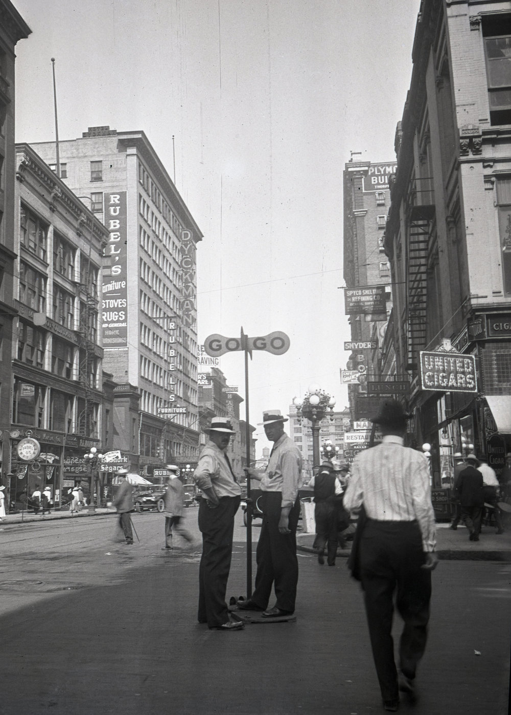 Before the invention of traffic lights, you might have seen men with a sign at busy intersections