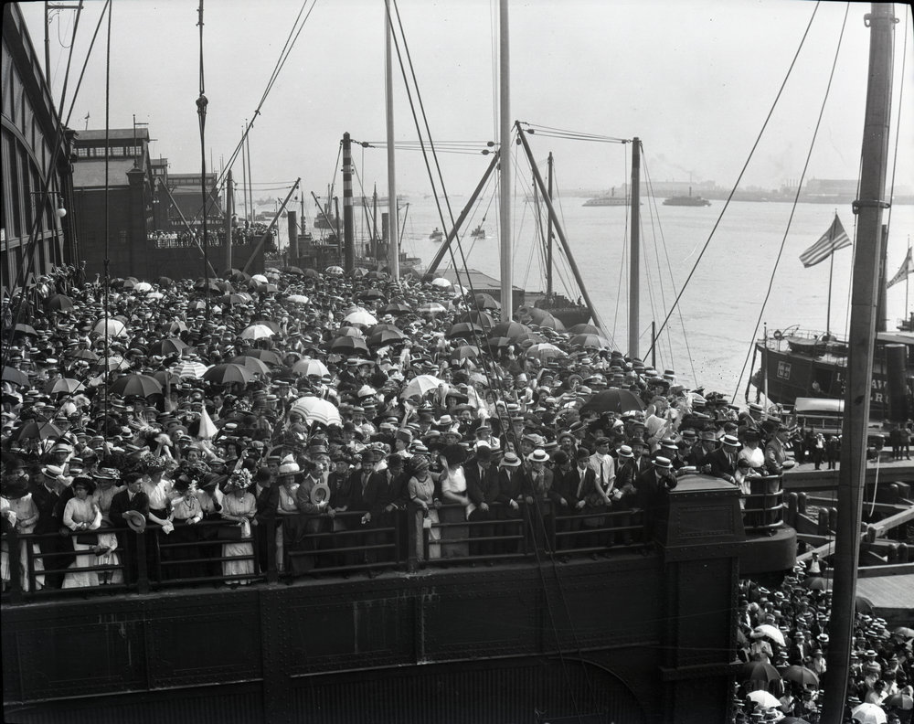 A crowd on Pier 59 in New York City where ships arrived or left