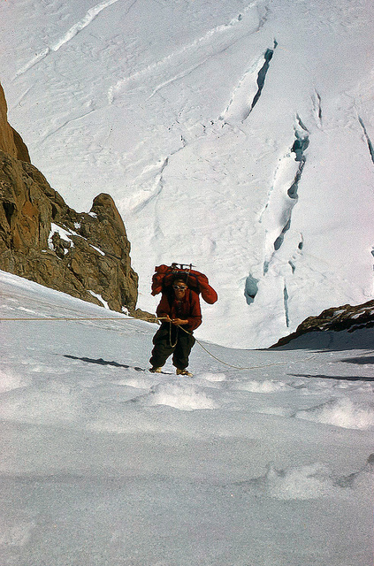 Jake in Col getting a rather late start the next morning, we all carried loads to the   top of the fixed ropes. Relentless, it continued as it had the night before-   steep hard ice. Another 800 feet of fixed rope went in. Then, joyful moment! We stood on the ridge crest again, gazing down at the ridge we had circumvented. I shuddered as I thought again of carrying loads up the ridge. No, the ice gully was the right way.