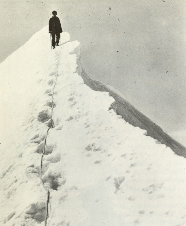 """""""Descending a snow ridge on the Mönch on our manless climb."""" Photo by Micheline Morin, from Give Me the Hills, 1971 edition."""