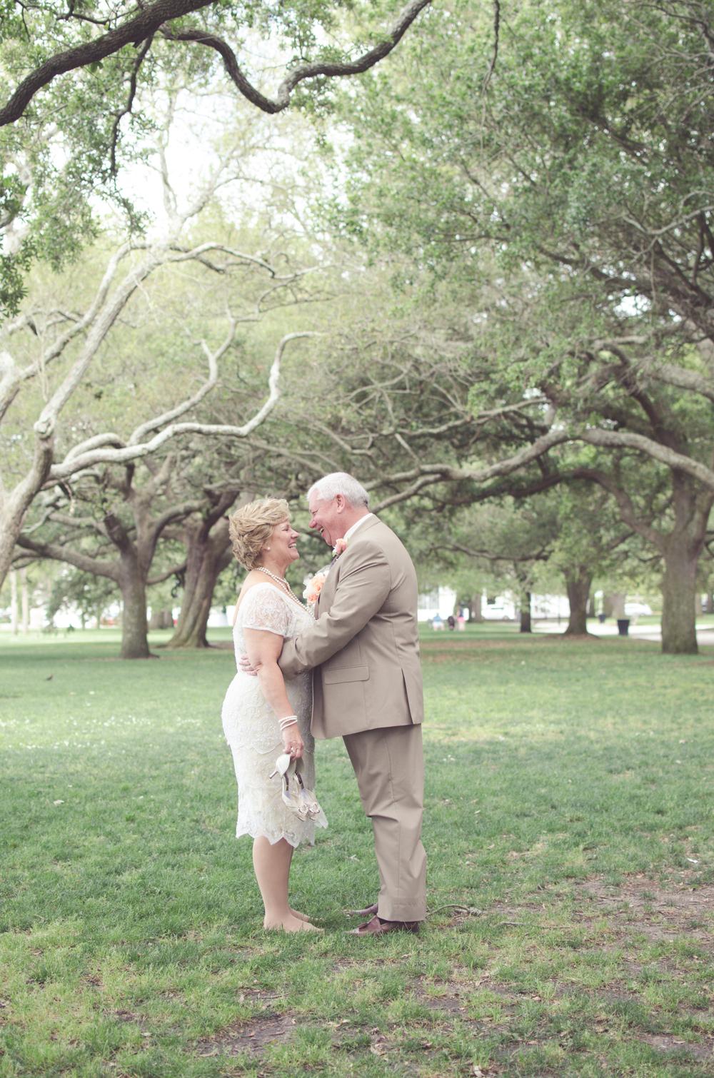 charleston wedding photography photographer bride and groom kiss white point .jpg