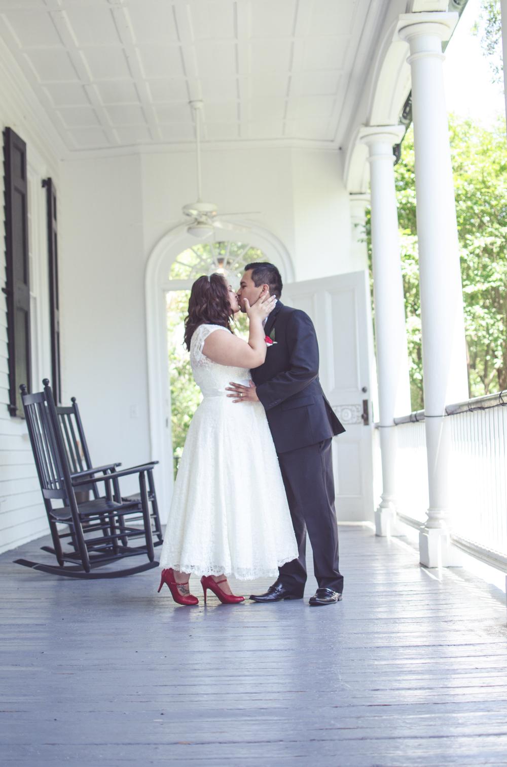 charleston wedding photographer photography bride and father gov thomas bennett house kiss.jpg