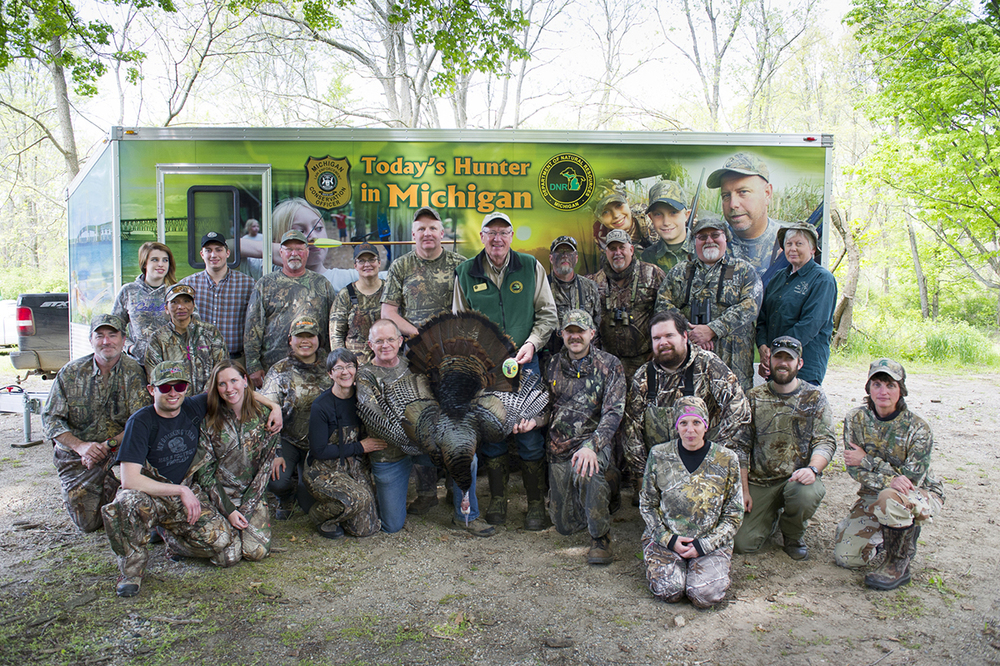 The group gathered for the recent Learn to Hunt outing at the Barry State Game Area poses for a photograph.