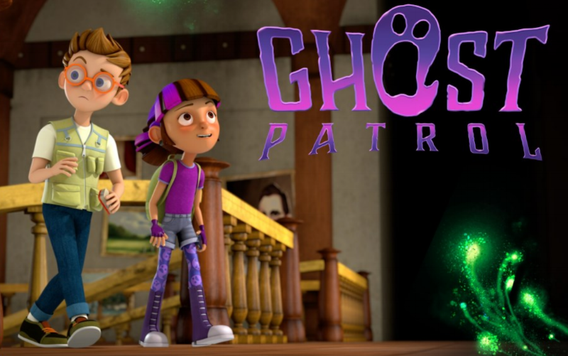 "Beside the purple Ghost Patrol logo (the O in ""ghost"" is the open mouth of a ghost), two kids walk on the landing of a mansion: Spence has short brown hair, orange glasses and a vest with many pockets. Gabi has brown hair with a purple stripe and carries a backpack. Image links to source image at family.ca."