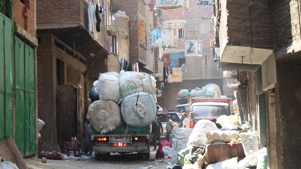 A Zabaleen garbage truck driving through Mokattam, Cairo (Source: Wikimedia Commons)