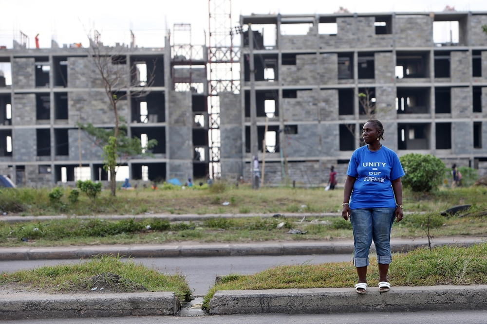An evicted woman stands in front of what used to be Badia East slum, cleared to make space for new middle class housing developments in the urban renewal zone financed by the World Bank. Source: International Consortium of Investigative Journalists  Flickr Page  (CC)