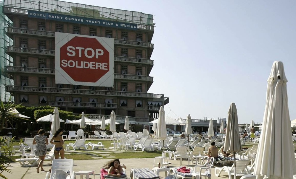Stop Solidere sign on the St George Hotel. Once a symbol of Beirut's golden age, the St George hotel today is but a hollow shell at the centre of an epic real estate battle pitting its owner against powerful developers. Image Source: Facebook posting, unknown source