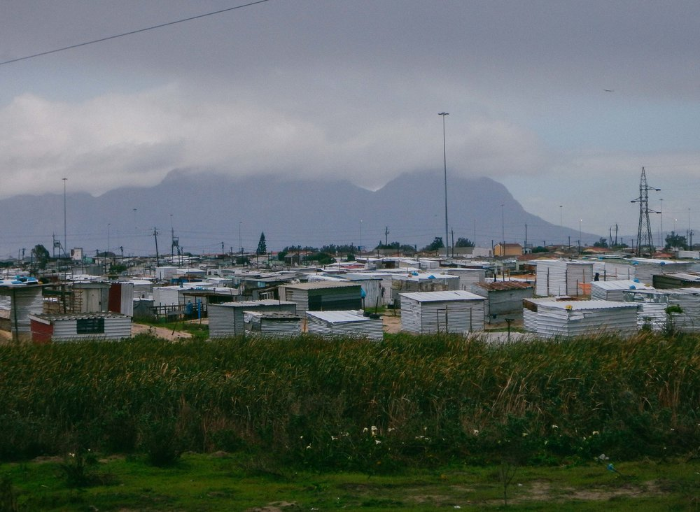 The high residential density in townships have results to land occupations near sensitive wetlands. Photo: Walter Fieuw