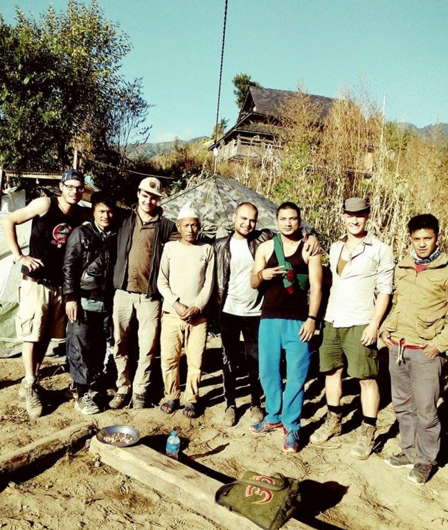 Volunteers, Village leaders and the beloved cook at the campsite. From left to right, ( volunteer Arnaud, village leader Tikaram Rumba Lama, volunteer Erich Burton, Sundar the cook, Translator DN, Nish Dai, Volunteer Florian, Engineer Nitesh.      Article and Photos by Volunteer Erich Burton