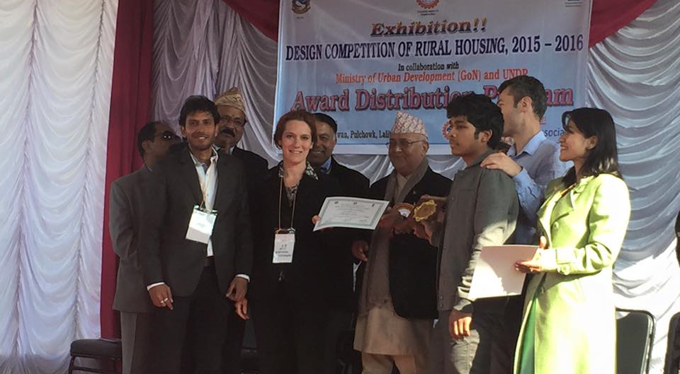 "Receiving an award from Prime Minsiter Oli of Nepal for ""Best Rural Design"" in a competition organized by Nepal Engineers Association"