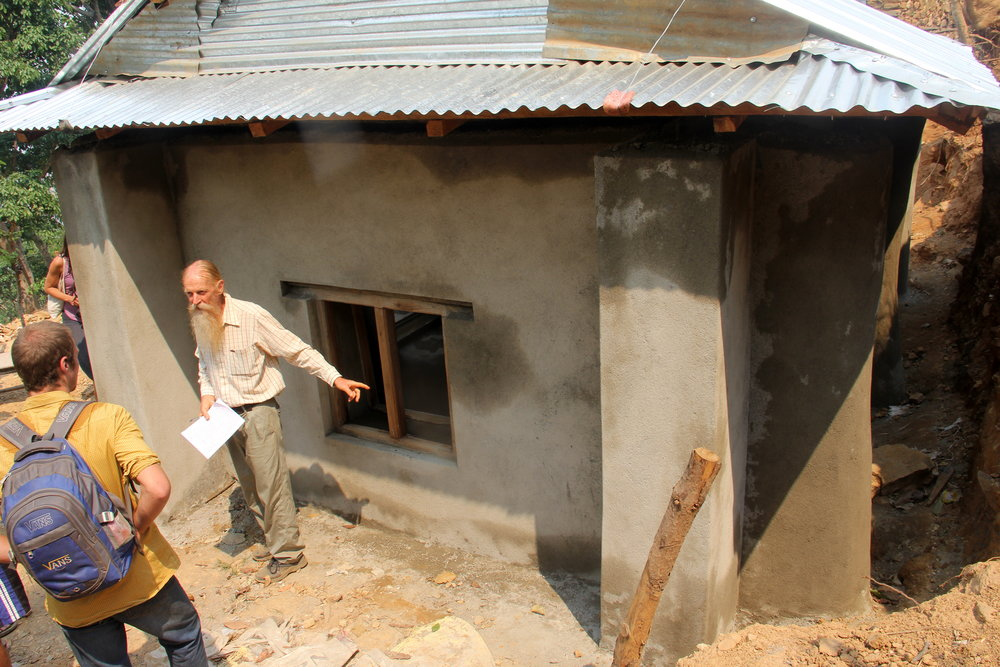 Dr. Owen Geiger inspecting Earthbag houses