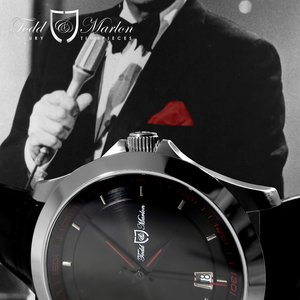 A touch of red on the dial to pay homage to Dean's signature red pocket square.