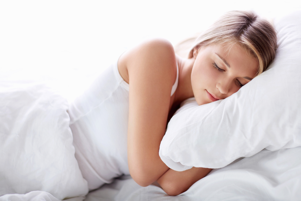A woman sleeping deeply. Deep sleep can increase BDNF levels.