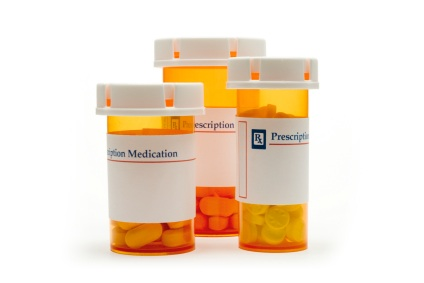 Three bottles of prescription medication. Prescription medications can sometimes cause brain fog as a side effect.