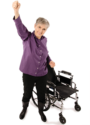 Dr. Terry Wahls standing in front of her wheelchair.