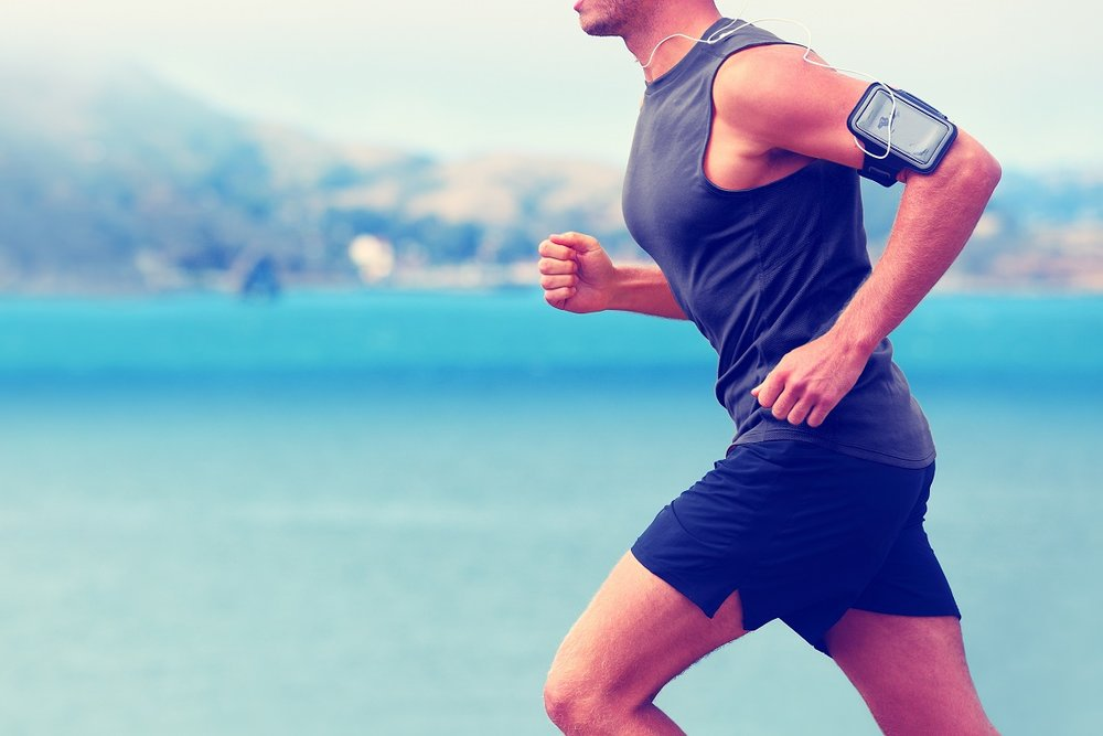 A man running near the water. Exercise stimulates the vagus nerve.