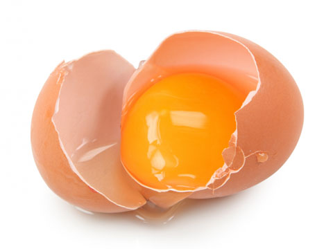 A broken egg and egg yolk. Egg yolks contain antioxidants that can protect you have excessive blue light exposure.