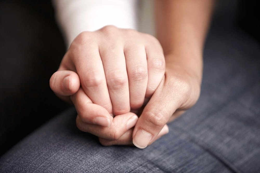 Two people holding hands. Forgiving one another can help us overcome trauma and PTSD.