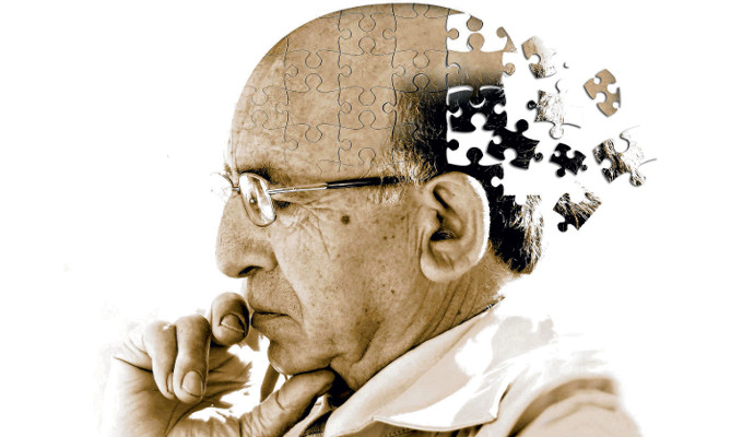 An elderly man sitting and thinking. EMFs contribute to dementia and cognitive decline.