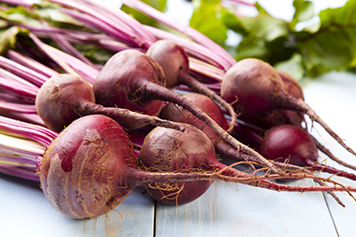 An image of beets. Beets contain betaine, which has been shown to lower homocysteine levels.
