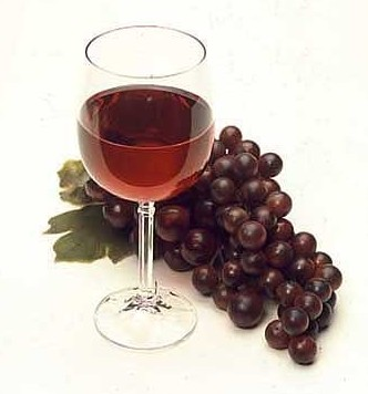 A glass of red wine and red grapes. Red wine and red grapes contain resveratrol, an antioxidant that can increase blood flow to the brain.