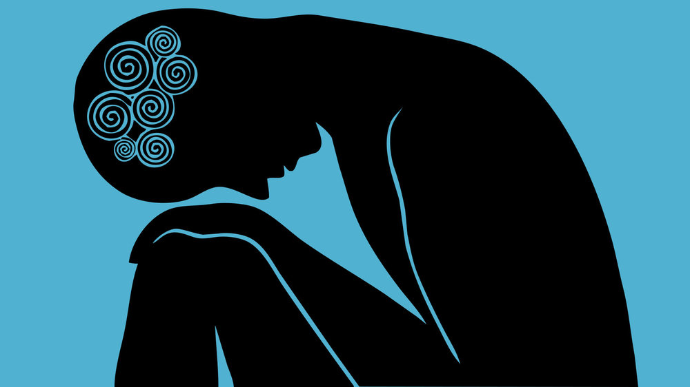 A silhouette of a person looking anxious, stressed and depressed.