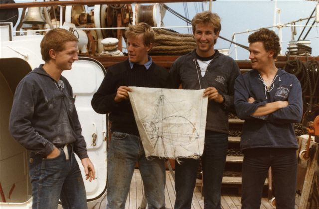 SEA CLOUD - crew with drawing on sail fragment after a gale
