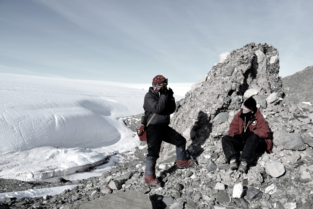 Geologist Sidney Hemming and a colleague from Lamont-Doherty Earth Observatory are shown examining glacial debris along the edge of Antarctica's Foundation Ice Stream.   They're studying how ice sheets in this area respond to changing climate // photo. Trevor Williams