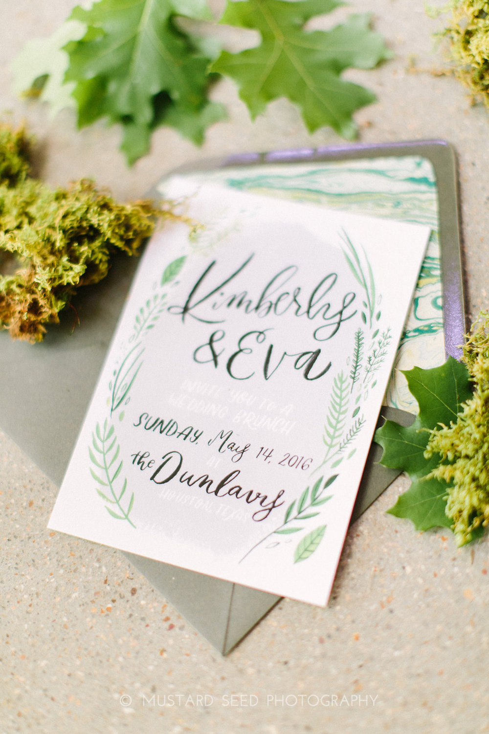 custom hand lettered invitation with leaves