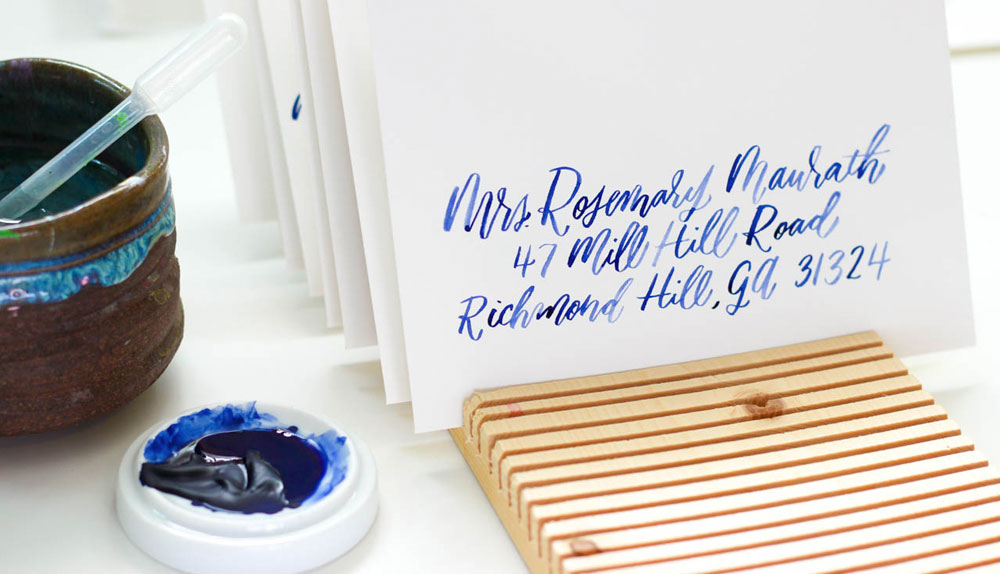 Hand lettered calligraphy addressing,navy on cotton.