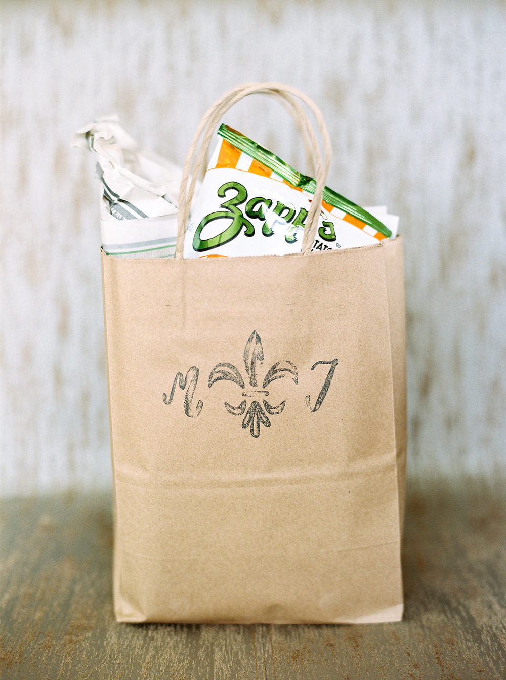 custom stamped fleur de lis welcome gift bag