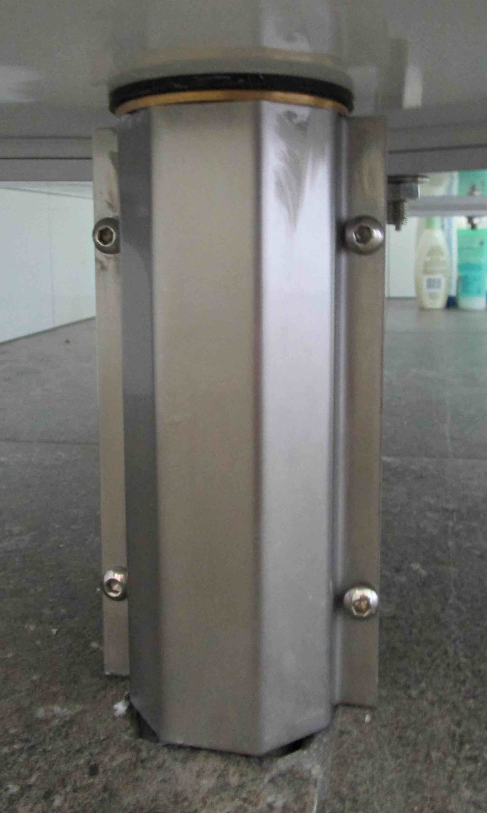 Bath drain pipe cover.  Stainless steel polished folded plate, stainless steel button head bolts and locknuts
