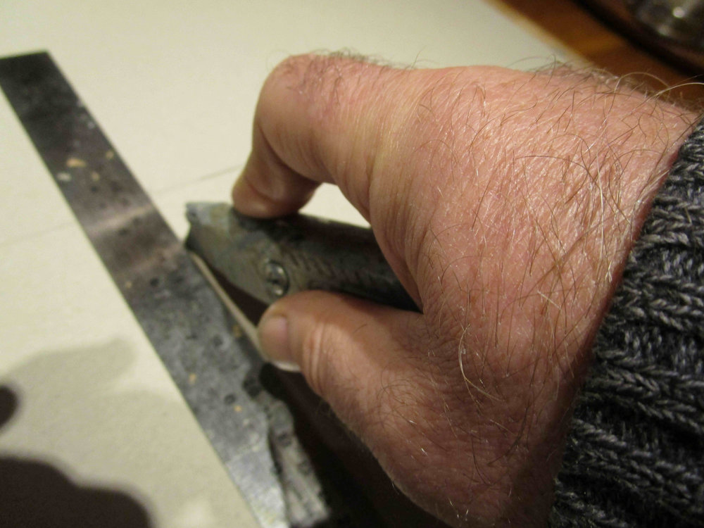 Cut on marks, keep non-cutting hand clear or clamp the steel ruler to be safe