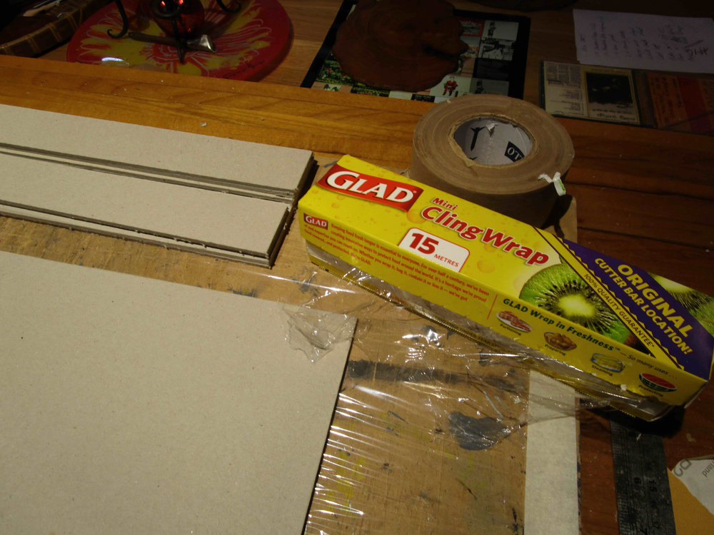 Line gluing and cutting board with cling wrap