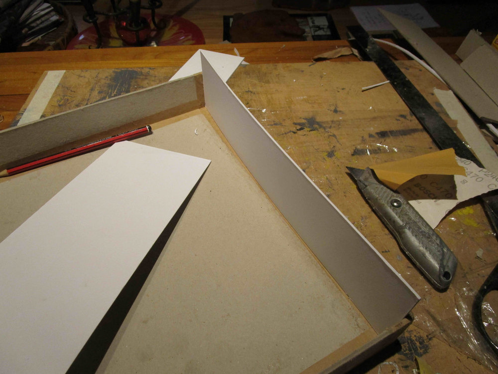 Fitting cut lid guides. Acid free photo glue to avoid warping, PVA to help the budget. When fitting the box lid, ensure that the lid is fitted in place on the box before gluing the last 2 sides, to ensure a snug fit.