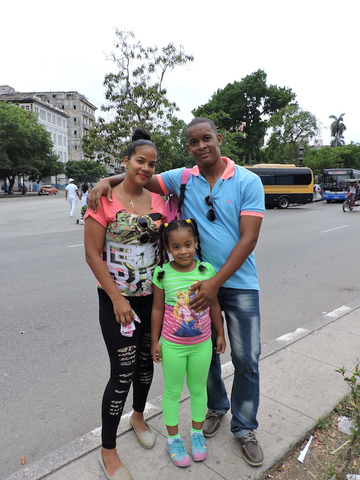 A Black Cuban family poses near Hotel Saratoga in Havana. Census data varies when it comes to determining the size of the island's Black population. However, historians suggest that at least two million enslaved Africans were shipped to the island. (Photo by Moriah Ray)