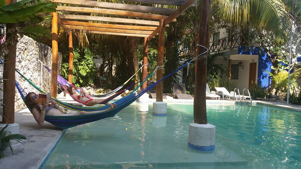 MEXICO - Reading by the hostel pool