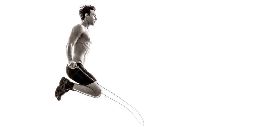 young-man-exercising-jumping-rope-silhouette-one-caucasian-studio-white-background-38900807.jpg