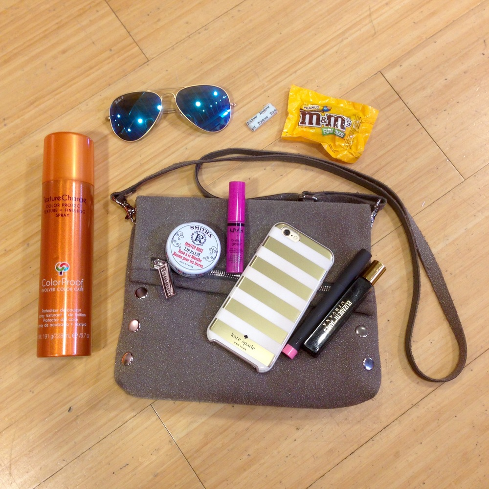Hammitt Bag Essentials:  Color Proof Texture Change finishing spray | Rosebud Perfume Co. Minted Rose lip balm | NYX Butter Gloss | iphone | BITE lipstick | Elizabeth & James Nirvana Black fragrance | Ray Ban Aviator sunnies | Peanut M&Ms | Tident gum