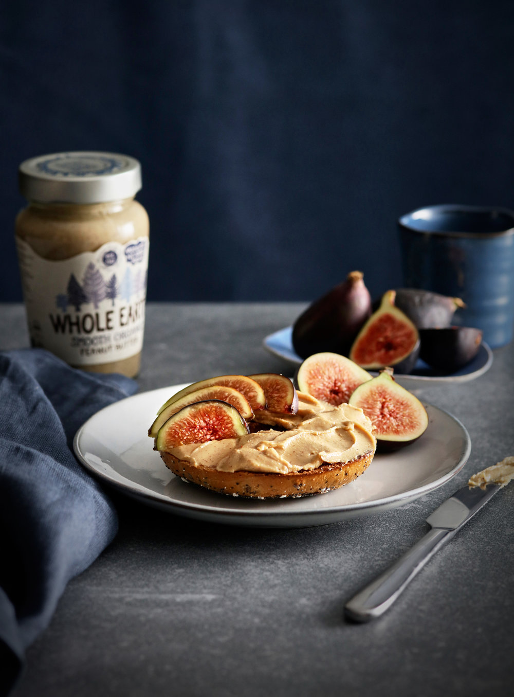 Peanut butter on bagel with figs