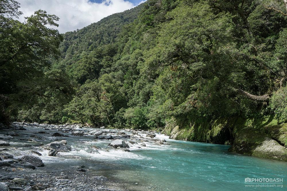 Turquoise-River-Lush-Cyan-Stream.jpg