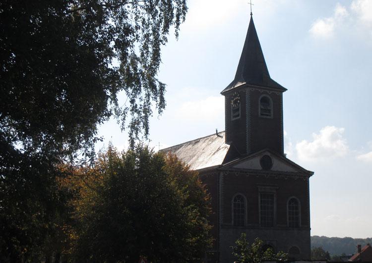 Kerk Sint-Jan Evangelist Blanden: zich op de voorgevel naar het ontwerp van architect Louis Montoyer. RC. CEGAH