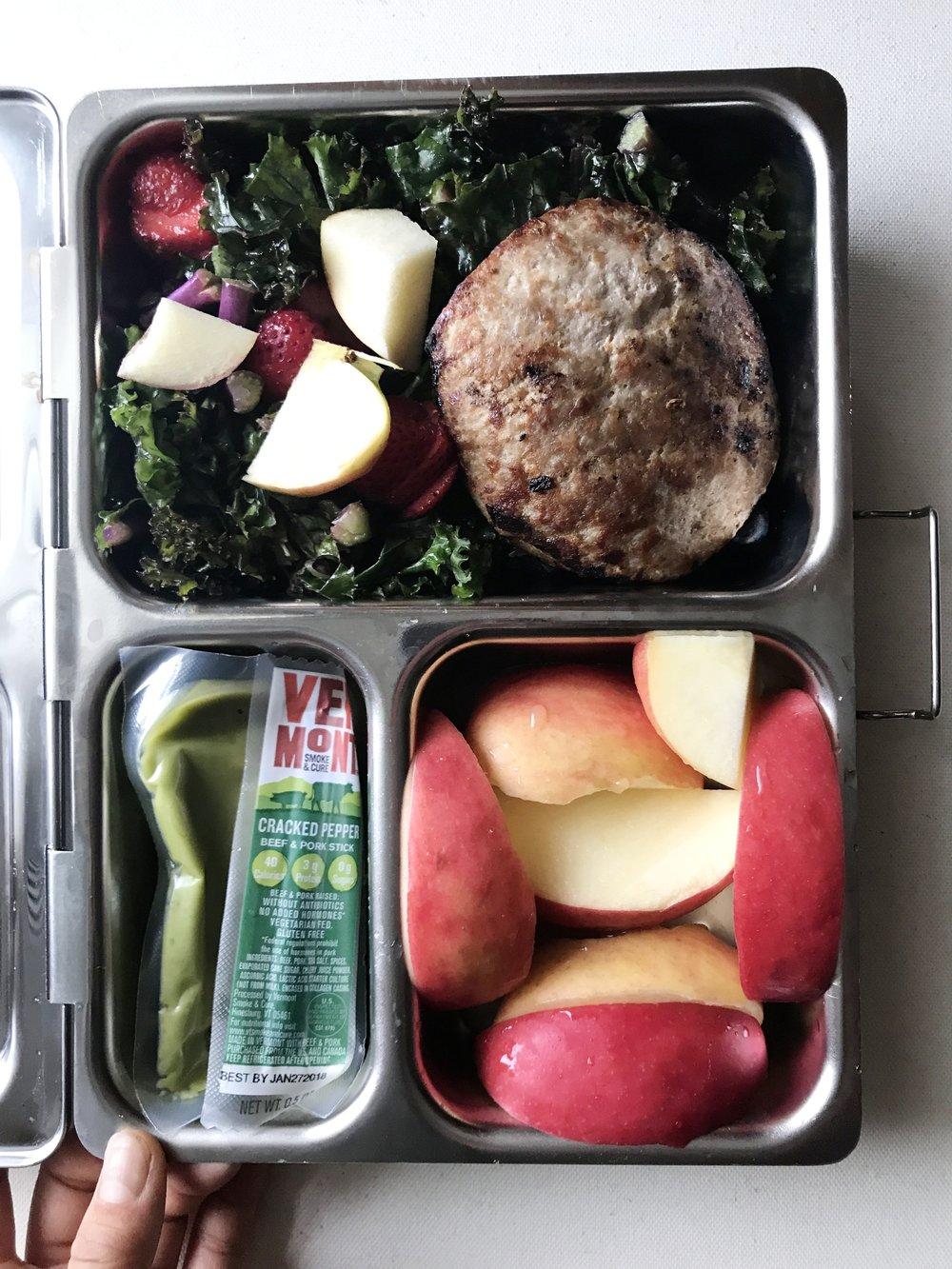 Kale with fruit, defrosted Trader Joe's turkey burger, Trader Joe's guac packet,  VT Smoke mini meat stick , sliced apple