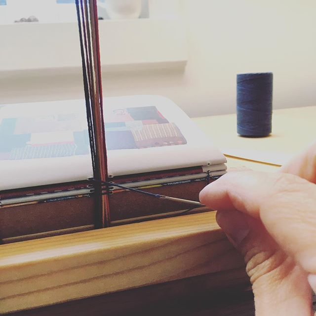 Sewing on embroidery thread instead of tapes or cords, inspired by the amazing embroidery work in Stitchillo. . #ovenbirdbindery #bookbinding  #bookbinder #books #booksofinstagram #bookstagram #bookish #booklover #handmade #handmadebooks #rarebooks #stitchillo #stitchillobinding #stitchillobook #uppercasemag