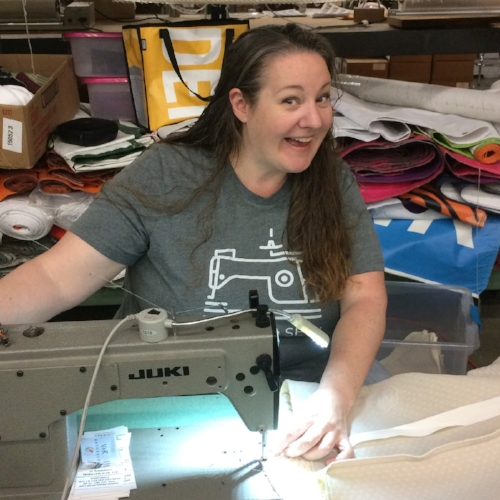 Sarah Sinner   Production Mentor   I started at Mile High WorkShop in April of 2017 and I am currently the Sew Shop Assistant Manager.  My work include, but is definitely not limited to, creating task sheets for employees, assisting in training new employees, and assisting in overseeing production and quality control.  I also cut fabric and sew....a lot! I enjoy it immensely.  My favorite thing about Denver (I am a native) is there is always something going on to keep people entertained. You will never run out of things to do here.....ever.